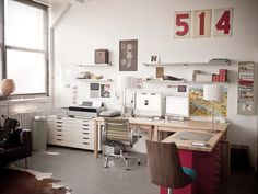 Possibly the most lovely workspace I've ever seen. Cluttered and homey, yet somehow serenely monochromatic.