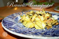Country style scrambled eggs with mushrooms, artichoke, asparagus and nuts