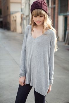 Oversize gray sweater paired with black leggings and knit cap...a sweet and feminine take on Street Style.....couturecheri