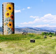 silo painted with sunflowers. marvelous