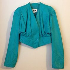 """Vintage Turquoise Leather 80's Jacket A warm rich turquoise leather jacket in a fabulous cropped style. So 80's with pleated shoulders and back waist. Fully lined interior and snap button closure. 18"""" long and in excellent condition! Brand: CHIA CHIA Jackets & Coats Utility Jackets"""