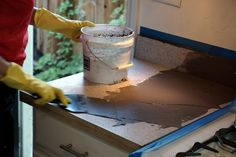 Applying the Feather Finish concrete skim-coat to the laminate countertop