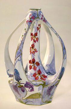 Rozenburg porcelain, four handled Art Nouveau vase decorated with orchids