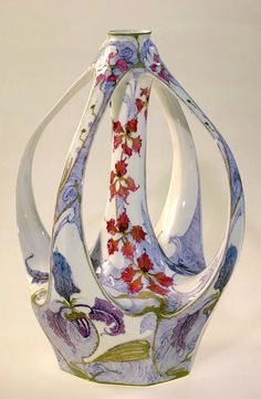 Rozenburg porcelain, four handled Art Nouveau vase decorated with orchids