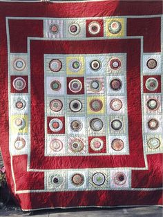 """Holly Disterhoft  I wanted to share my version of  Dots for Tiny Tots from the Fons & Porter's Easy Quilts Summer 2008 issue. I love Sharon Smith's version of this baby quilt. I made it into a full size quilt (82""""x90"""")  I added another row of the circle blocks, a wide red border on the edge, and the green edging throughout. I love the whimsical nature of this quilt with the crazy offset circles and the polka dots against the stripes."""