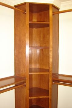 corner Closet | Custom cherry corner unit in walk in closet
