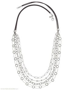 Forever fascinating in its multiplicity. Various Chains hang on a Suede Cord. Cubic Zirconia, Sterling Silver.