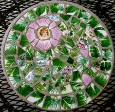 Pique Assiette Mosaic Stepping Stone by Emily Hickman.  Green, pink, palm trees, cherub.
