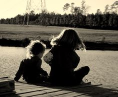 Some precious little girls, fishing off the dock!