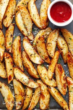Crispy Garlic Baked Potato Wedges are soft pillows on the inside, and crunchy on the outside with a good kick of garlic and parmesan cheese! |