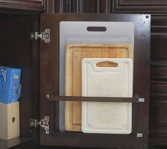 Great idea for cutting board storage holder on the inside of cabinet doors @istandarddesign