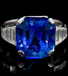 An Art Deco Platinum, Sapphire and Diamond Ring, French, containing one octagonal step cut sapphire weighing approximately 11.48 carats and eight tapered baguette diamonds weighing approximately 0.64 carat total. Stamp: 1270 (French German Shepherd assay mark). Hand Inscribed: FRANCE.