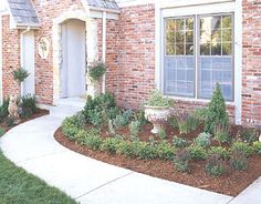 This entry perennial garden features easy-care plants that look good year-round.