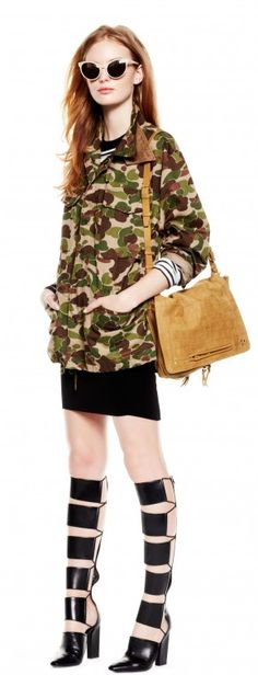Update a simple black dress with a camo jacket and knee-high gladiator sandals.