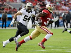 Saints vs. 49ers:  November 6, 2016  -  41-23, Saints  -     San Francisco 49ers running back DuJuan Harris runs with the ball past New Orleans Saints inside linebacker Nate Stupar (54) during the first half of an NFL football game, Sunday, Nov. 6, 2016, in Santa Clara, Calif.