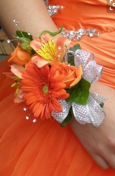 Wrist corsage with orange alstroemeria and gerbera daisy with silver. @ Caitlin, I like this for the grooms-women if we are doing wrist corsages. They have some of the same flowers I would like to use in the bridesmaids bouquets. Prom Corsage And Boutonniere, Corsage Wedding, Wedding Bouquets, Boutonnieres, Prom Wrist Corsage, Homecoming Corsage, Wedding Bridesmaids, Prom Flowers, Silk Flowers