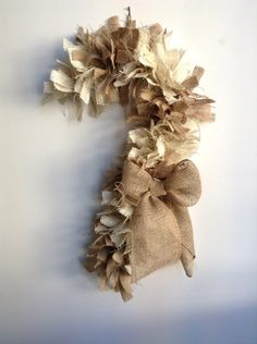 A personal favorite from my Etsy shop https://www.etsy.com/listing/166834117/burlap-christmas-wreath-candy-cane