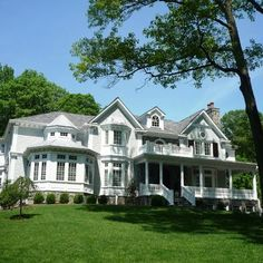 Short Hills Exteriors  Woodfield House  Classic white shingle and stone with wrap around porch.
