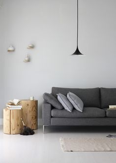 woven grey sofa, raw wood end tables, minimal//