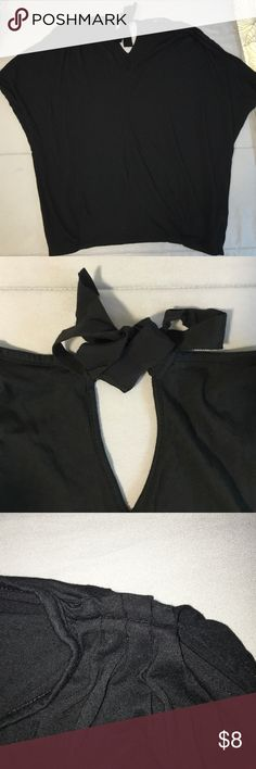 Black sleeveless top! Black v-neck sleeveless top from Gap! Never worn. Cinched shoulder and tie on back by the neck. I'll model it if needed! :) size small but flowy GAP Tops Blouses
