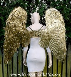 http://lamourleallure.storenvy.com/collections/1308735-wings/products/18638620-extra-large-rhinestone-gold-angel-wings-cosplay-dance-costume-rave-bra-hallo