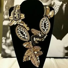 Avon Beaded Ribbon Tie Necklace Like New - Black, gold and rhinestone beaded necklace with a ribbon tie. 9 to 18 inches long depending on how you tie it. Avon Jewelry Necklaces