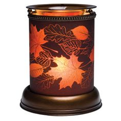 Autumn Glow Shade Scentsy Warmer ~ Radiant as the late autumn twilight, Autumn Glow's swirl of falling leaves is brilliant against frosted royal purple glass. Only available during the 2013 holiday season while supplies last! Scentsy, Wax Warmers, Fall Is Here, Scented Wax, Purple Glass, Hand Blown Glass, Fall Halloween, Autumn Leaves, Fall Decor