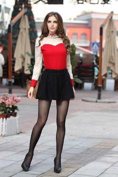 Black mini skirt with sheer pantyhose.