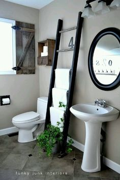 Love this. Using a latter for a towel rack.