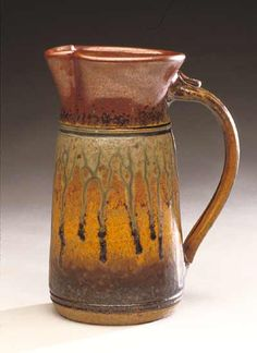 Ceramic Pitcher  created by Mike Walsh -  wheel-thrown and hand-built stoneware pitcher, decorated with iron and ash glazes - really like this piece...