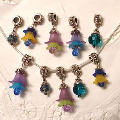 '5 Pairs of Handmade Floral  & Crystal Euro Charms' is going up for auction at  4pm Wed, Aug 28 with a starting bid of $4.