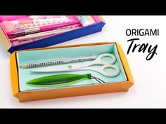 A long origami tray to keep pens, pencils or other items. This long origami box has handles on either side. It's easy to make, no glue is needed. Origami Cube, Modular Origami, Origami Folding, Origami Easy, Origami Boxes, Origami Instructions, Origami Tutorial, Paper Crafts Origami, Diy Paper