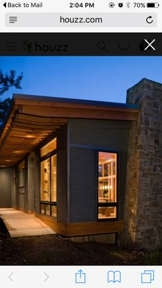 "Exterior: combination of rock, painted hardy plank, cedar, black aluminum, large, ""store front"" windows"