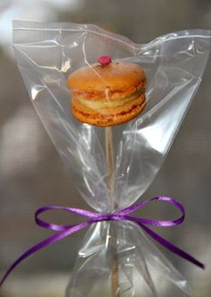 Orange Macaron On A Stick Wred In Small Plastic Bag Tied With Purple