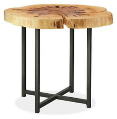 Our Allard end table displays its heritage. These sugar maple tops come from a family-run farm in Vermont, where the trees are tapped every spring for syrup. The cross sections of the wood show where each one was tapped over the decades to extract the sap. Skilled artisans carefully sand each piece, creating an exceptionally smooth feel while highlighting the grain. A steel base lends a fresh mix of materials to fit into any room.
