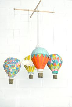 Create+a+beautiful+Hot+Air+Balloon+mobile+complete+with+little+clouds+with+this+luxe+DIY+kit.+ The+kit+includes:+ ------------------------------------- Pure+wool+felt+for+clouds+and+baskets Matching+DMC+embroidery+perle+ Fusible+webbing Sa.