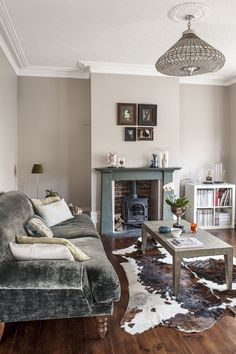 Grey is a predominant backdrop, blending into all the individual schemes within each room and seamlessly uniting the whole house together Formal Living Rooms, Home Living Room, Living Spaces, Living Area, Georgian Interiors, Brownstone Interiors, Cowhide Decor, Hallway Designs, Edwardian House