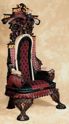 You'd be the king of your castle with this! Hand Carved Rosewood Inlaid Chair by Gallivan's Art Furniture.