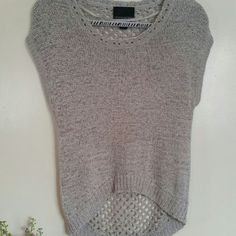 Sweater top Grey/silver short sleeved top..very cute. Hi/low crochet top. Dress up or wear casual. You get to decide!! Tops Crop Tops