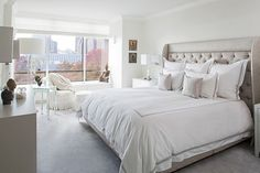 Beautiful White Bedroom Design With Deluxe Bed And Lovely Lounge Chair By The Window Side Decorated With Modern Lamps Ideas Bright Eclectic Interior of an Apartment in Manhattan with Panoramic Views Apartment http://seekayem.com