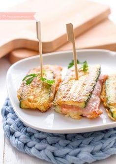 Receta de Sanjacobos Ingredientes  1 calabacín     queso rebanado     100 g jamón      Pan rallado (con ajo y perejil) para rebozar     Harina de trigo     Huevo batido     Aceite