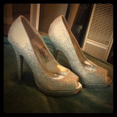 Barely worn shiny heels Worn around the house to try in but too big. Great condition, extremely sparkly and so gorgeous! Rampage Shoes Heels
