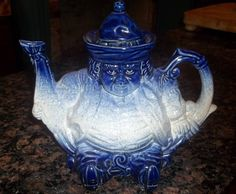 "Staffordshire Teapot Victoria Flow Blue British Toby Figural Art Pottery Nice | eBay...I already had this one in the flow blue, but found another one painted in very deep ""natural"" colors, very detailed as if it is a true sitting Toby.  Just beautiful!"