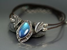 I love Labradorite.  This piece has a beautiful one.  I bezel set this stone in fine silver metal clay.- Lisa Barth