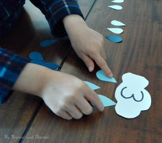 Make this Rainy Day Math game to help your preschooler practice number recognition, one-to-one correspondence and patterning. Activity Games For Kids, Preschool Math Games, Preschool Weather, Fine Motor Activities For Kids, Montessori Math, Preschool Lessons, Math For Kids, Kindergarten Math, Toddler Activities