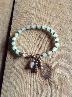 This bracelet is made with faceted Aventurine beads 6 mm, miyuki beads and a bronze clasp.  A verry nice bracelet for summer and to stack with.