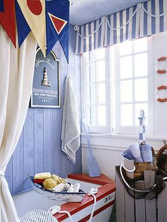 Ahoy!...love the use of knotted rope atop the valance to complete the nautical treatment of this fun window.