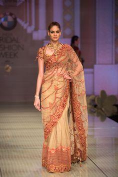Tarun Tahiliani red and beige bridal saree. More here: http://www.indianweddingsite.com/bmw-india-bridal-fashion-week-ibfw-2014-tarun-tahiliani-show/