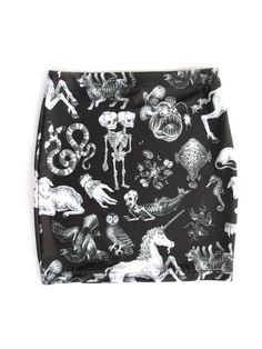 Freak of Nature print mini skirt inblack. Original print by Pretty Snake illustrated byJulian Farmar-Bowers. 86% Polyester14% Spandex  Print placement may v