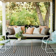 Add instant character to a new porch with a pair of vintage metal chairs painted with two coats of an exterior oil-based color.